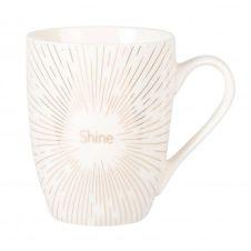 Mug en porcelaine blanche et dorée