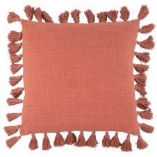 Coussin en coton terracotta à pompons